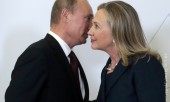Russia's President Vladimir Putin (L) meets U.S. Secretary of State Hillary Clinton upon her arrival at the Asia-Pacific Economic Cooperation (APEC) Summit in Vladivostok September 8, 2012.    REUTERS/Mikhail Metzel/Pool (RUSSIA  - Tags: POLITICS)